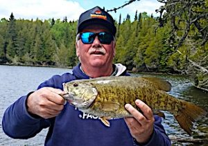 Father And Son Trophy Smallmouth Bass Fishing in Canada by Jim