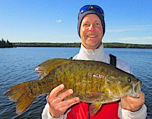 Enormous Trophy Smallmouth Bass Fishing at Fireside Lodge by Don in Canada