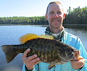 HUGE Trophy Smallmouth Bass Fishing at Fireside Lodge in Canada by Don Landbo