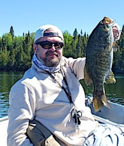 Many Trophy Smallmouth Bass Like This Fishing by Steven in Canada