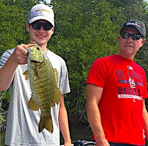 Gage with1 of Many Trophy Smallmouth Bass Fishing in Canada