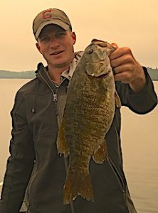 Smoky Day Trophy Smallmouth Bass Fishing by Jonathan in Canada