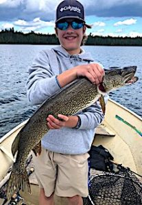 Tyler Pim With a HUGE Northern Pike Fishing at Fireside Lodge in Northwest Ontario Canada