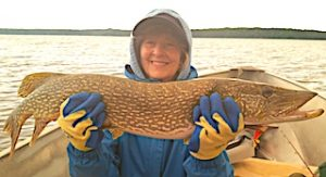 Millie with Her Biggest Northern Pike Fishing at Fireside Lodge in Northwest Ontario Canada