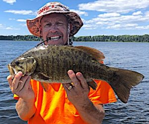 Trophy Smallmouth Bass are Common Fishing by Ron at Fireside Lodge in Canada