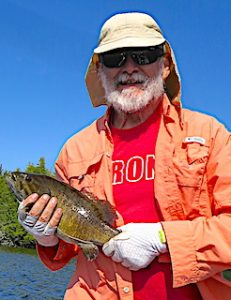 Ted With a Trophy Smallmouth Bass Fly-Fishing at Fireside Lodge in Canada