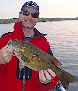 Chris Holding a Master Anglers Award Smallmouth Bass Fishing in Canada
