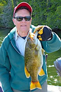 Trophy Smallmouth Bass Fishing by Larry in Ontario Canada