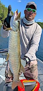 Marty with Another Large Muskie Fishing in Ontario Canada