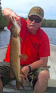 Buddy Having a Ball Fishing at Fireside Lodge in Canada for Pike