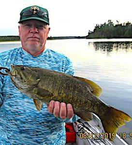 Walt with 1 of 3 Trophy Smallmouth Bass Fishing at Fireside Lodge in Northwest Ontario Canada