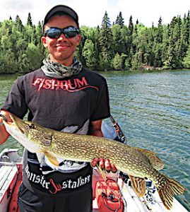 Keeghan Fishing BIG Northern Pike with Grandpa at Fireside Lodge in Canada