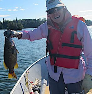 1st BIG Smallmouth Bass Fly Fishing by Jan at Fireside Lodge in Ontario Canada