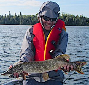 Jan with Her 1st Northern Pike Fly-Fishing at Fireside Lodge in Ontario Canada