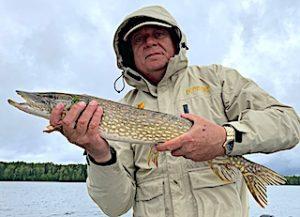 Dave Having Fun Fishing Northern Pike in Ontario Canada
