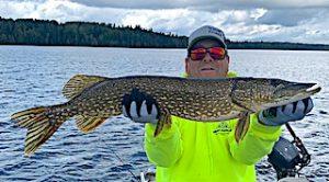 Steve Fishing Big Northern Pike at Fireside Lodge in Canada